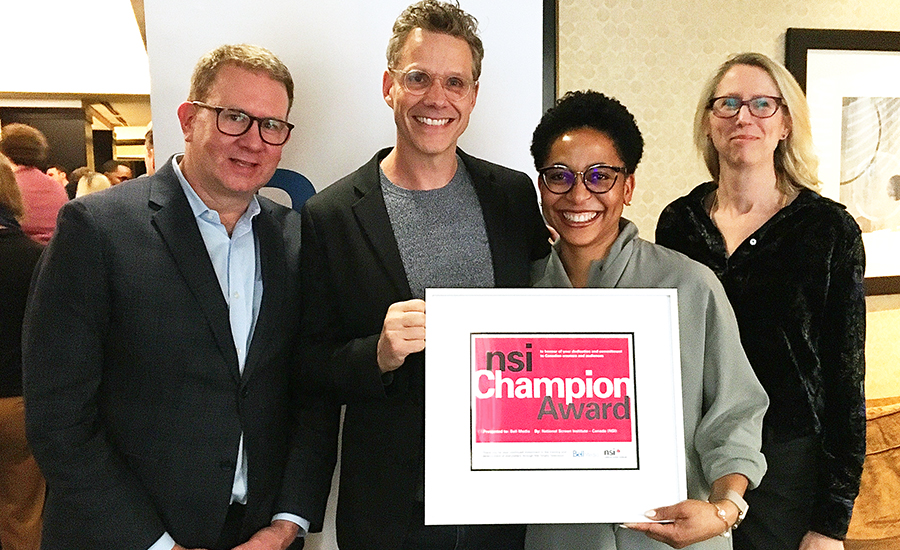 Bell Media's Scott Henderson, Tom Hastings and Corrie Coe receive an award from NSI's CEO Joy Loewen to thank them for their ongoing partnership
